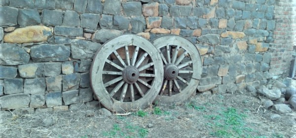 Bullock Cart Wheels Outside House in Village